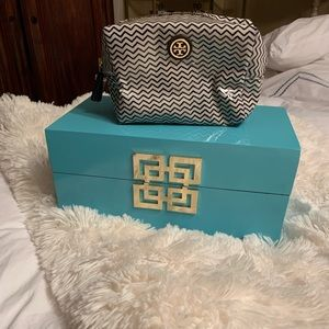 Small Tory Burch cosmetic bag.
